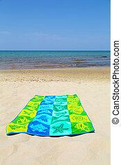 towel on beach - colorful towel on a beautiful beach