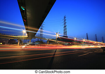 Long exposure photographs of urban night dusk road traffic -...