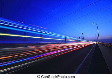 Highway bridge at Night - Car lights on a highway and...