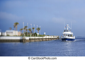 Ferry boat in channel. - Ferry boat heading into port on...