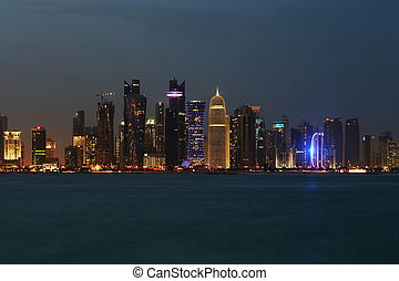 The West Bay Doha Skyline at Dusk - This dusk image of the...