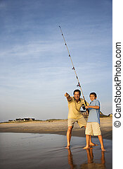 Father and son fishing - Caucasian mid-adult man shore...