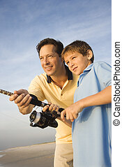 Father and son fishing. - Caucasian mid-adult man shore...