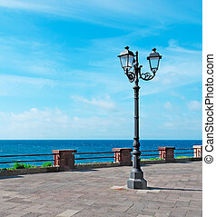 street pole by the sea - street lamp by Alghero sea