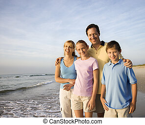 Smiling family on beach. - Portrait of Caucasian family of...