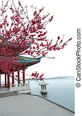The red pavilion Ancient building next to West Lake in...
