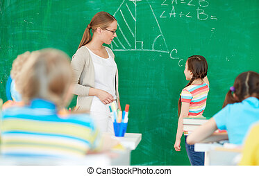 Explaining formula - Portrait of smart teacher standing by...