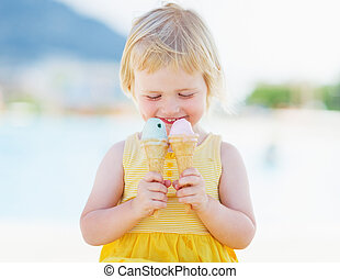 Happy baby with two ice cream horns