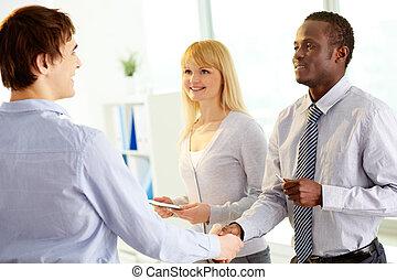 Businessmen handshaking - Portrait of happy leaders...