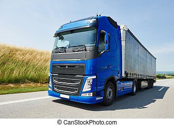 lorry with trailer driving on highway - Blue lorry cargo...