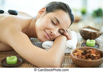 Bliss - Portrait of young female enjoying spa procedure in...