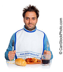 Guy with bib at the dinner table
