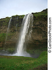 Iceland waterfall Seljalandfoss - Iceland waterfall and...