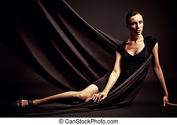 vogue shot - Art fashion photo of a beautiful woman in black...