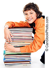 bibliophile - Happy schoolboy sitting with a stack of books....