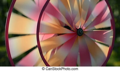 Colorful pinwheel rotates in the garden
