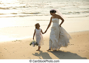 Bride and flower girl. - Caucasian mid-adult bride and...