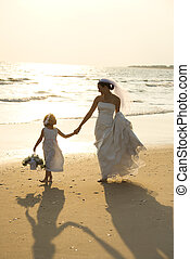 Bride and flower girl - Caucasian mid-adult bride and flower...