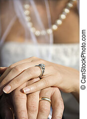 Wedding rings - Caucasian mid-adult male and female hands...