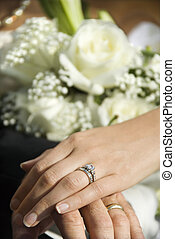 Wedding rings. - Caucasian mid-adult male and female hands...