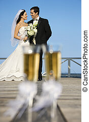 Bride and groom. - Pair of flute glasses of champagne with...