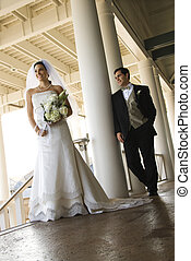 Portrait of bride and groom. - Caucasian mid-adult fbride...
