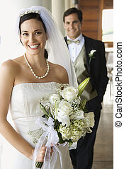 Portrait of bride and groom - Caucasian mid-adult bride and...