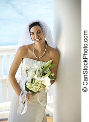 Portrait of bride. - Caucasian mid-adult bride holding...