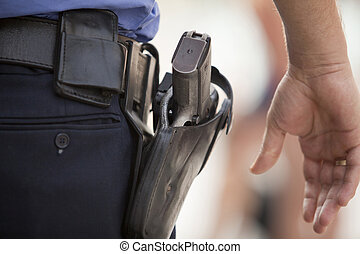 policeman - Police officer with handgun on his holster