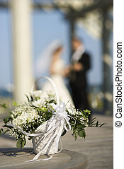 Flower basket at wedding. - Flower basket with Caucasian...
