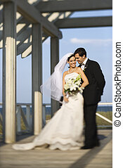 Bride and groom portrait. - Caucasian mid-adult bride and...