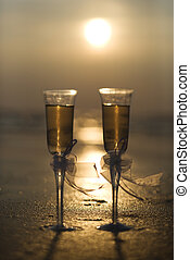 Champagne glasses - Pair of flute glasses filled with...
