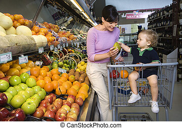 Mother grocery shopping.