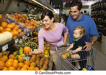 Family grocery shopping - Caucasian mid-adult parents...