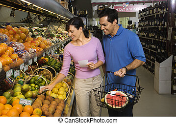 Couple grocery shopping.