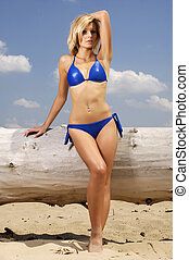 beautiful blonde woman in blue bikini - beautiful young...