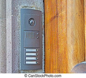 entry phone and wooden door