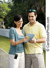 Couple holding map.
