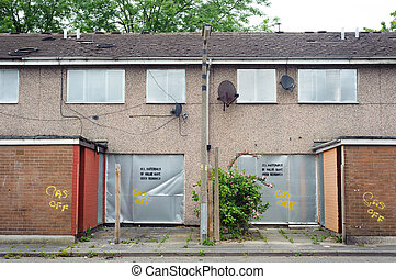 Abandoned terraced housing with metal shutters, Salford, UK...