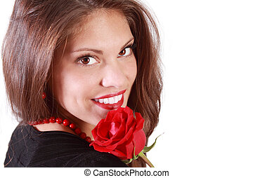 Happy young woman with red rose on her shoulder