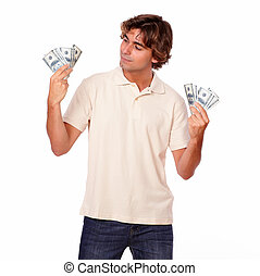 Charismatic fashionable man holding cash money - Portrait of...