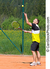 tennis player throw up ball to make service