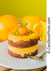 Cake - Orange Cake in white dish on the wood table