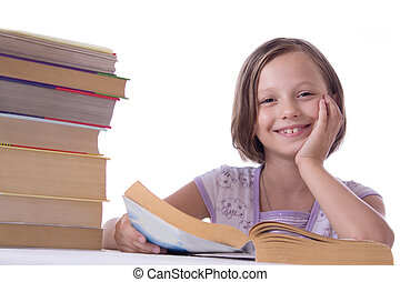 Smiling girl with pile of books