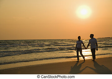 Couple holding hands. - Caucasian mid-adult couple holding...