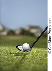 Golf club and ball. - Image of golf ball on tee with golf...