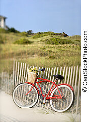 Bike at beach - Red vintage bicycle with basket and flowers...