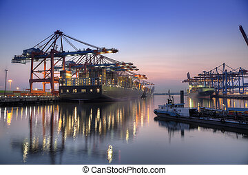 Harbour at night in Hamburg, Germany Container terminal with...