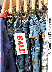 Jeans Outlet - Kids Fashion labelled by a sale sign