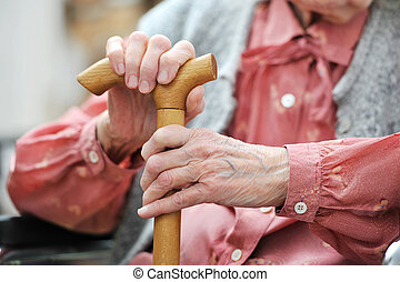 Old womans hands - Hands of the old woman with a cane